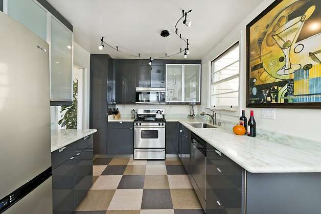 Track lighting tops the kitchen. Photo: Olga Soboleva