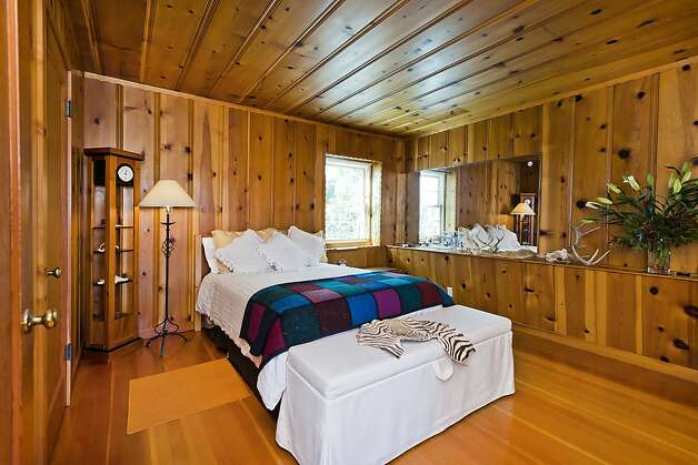 The downstairs bedroom has wood floors and walls and a wood ceiling. Photo: Olga Soboleva