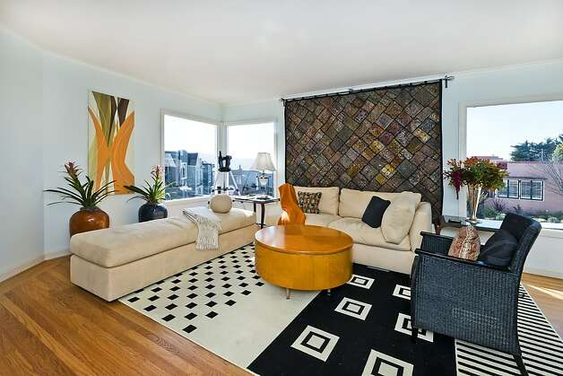 Large picture windows provide views of the city throughout the home. Photo: Olga Soboleva