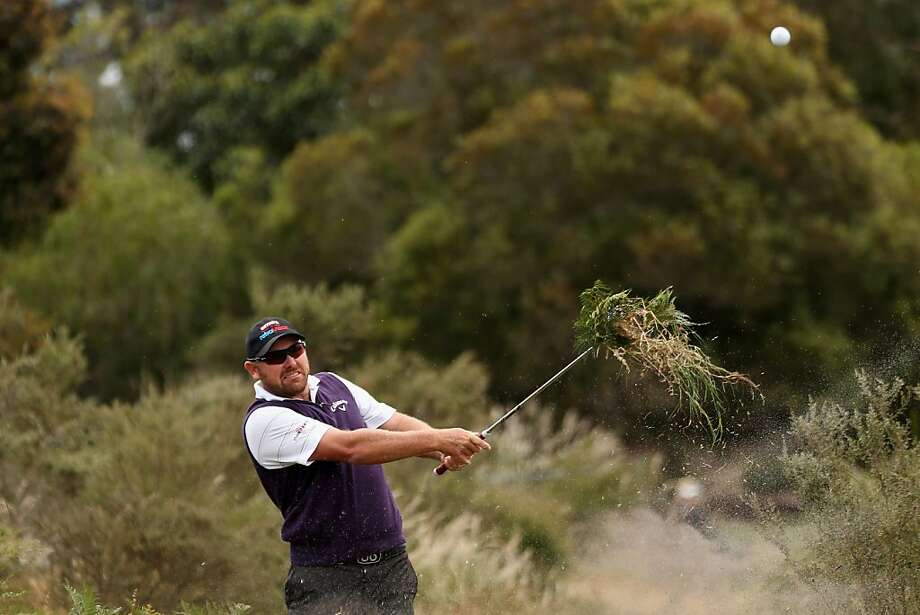 Weed whacker: Aussie David Bransdon shoots out of the tall grass at the Australian Masters at Kingston Heath in Melbourne, taking a good chunk of undergrowth in the process. Photo: Lucas Dawson, Getty Images