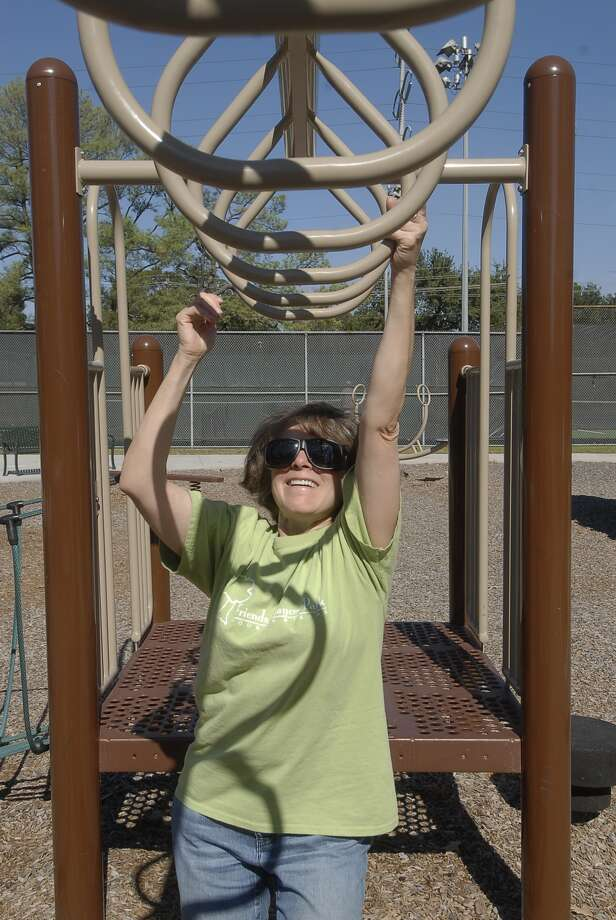 Darlene Wayt of Friends of Jaycee Park plays on the monkey bars at the park. The group is raising funds for canopies to shade the playground equipment. Photo:  Tony Bullard 2012, Freelance Photographer / © Tony Bullard & the Houston Chronicle