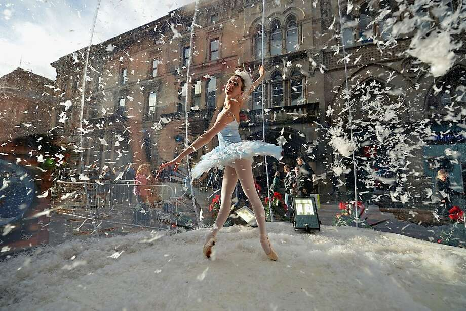 """Blizzard in a bowl:Ballerina Claire Robertson dances in a life-size snow globe on a Glasgow street during a promotion for the Scottish Ballet's production of """"The Nutcracker."""" Photo: Jeff J Mitchell, Getty Images"""
