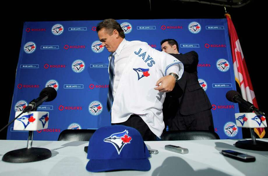 John Gibbons (left) was prepared to return for his second season in the Missions' dugout, but in a surprise move, the Blue Jays re-hired the skipper. Photo: Nathan Denette, Associated Press / CP