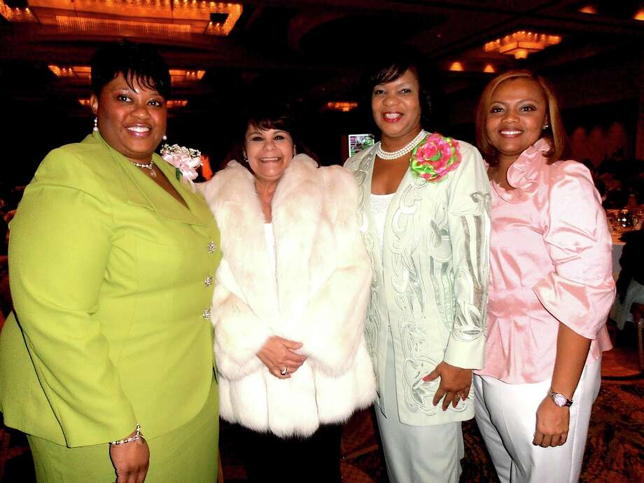 Alpha Tau Omega Chapter President Arla Johnson, from left, celebrates the success of the  Fashionetta  luncheon with raffle winner   and winner of a white fox jacket   Lisa Wehlend, event chair Sharon Crockett and Oanh Maroney. Photo: San Antonio Express-News