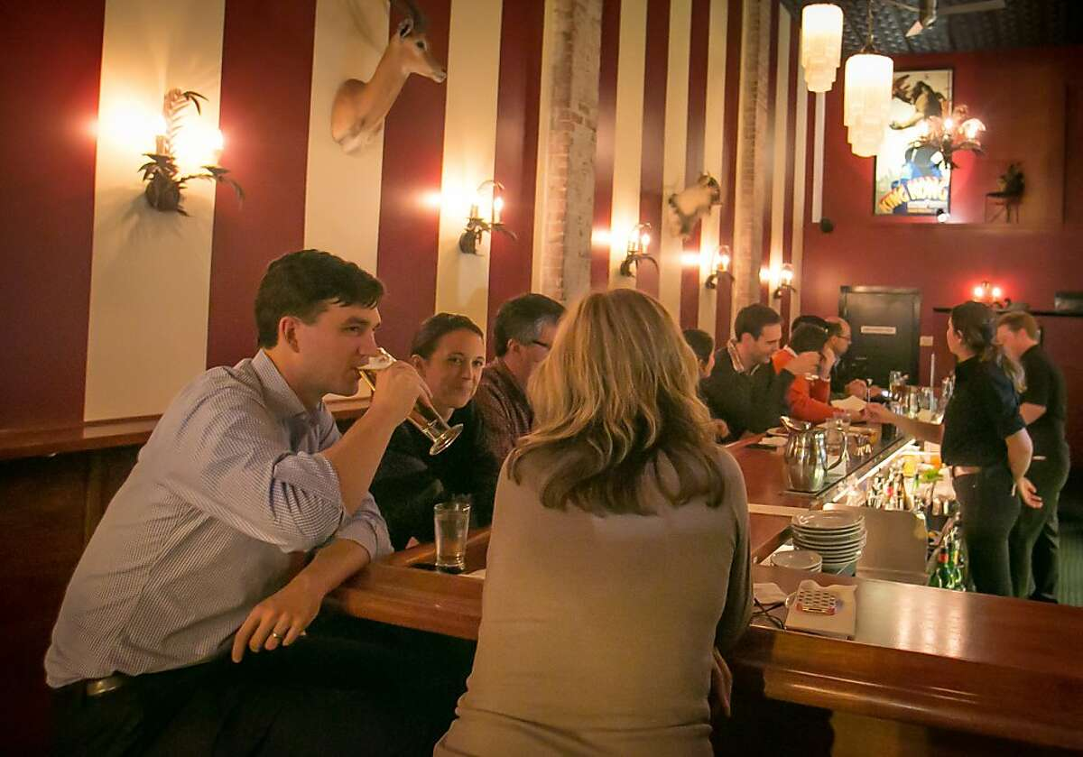 People enjoy happy hour at Fauna in Oakland, Calif., on Friday, November 16th, 2012.