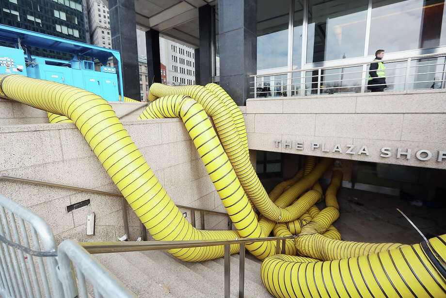 NEW YORK, NY - NOVEMBER 19:    Tubes carry hot air being pumped into a Financial District building that flooded in an attempt to dry out the building following Superstorm Sandy in lower Manhattan on November 19, 2012 in New York City. Many of the office towers in the low lying Financial District which flooded remain closed due to damage to heating and electrical infrastructure.  Many other buildings in the area are being powered by generators. Photo: Mario Tama, Getty Images / 2012 Getty Images