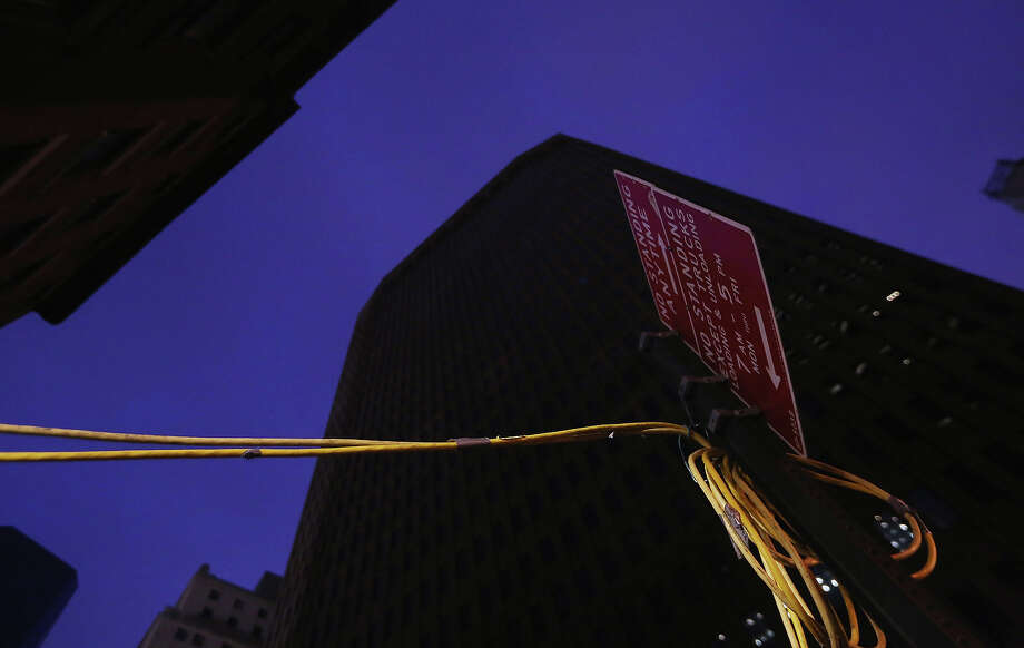 NEW YORK, NY - NOVEMBER 19:  Generator cables run into a Financial District building that flooded during Superstorm Sandy on November 19, 2012 in New York City. Many of the office towers in the low lying Financial District which flooded remain closed due to damage to heating and electrical infrastructure.  Many other buildings in the area are being powered by generators. Photo: Mario Tama, Getty Images / 2012 Getty Images