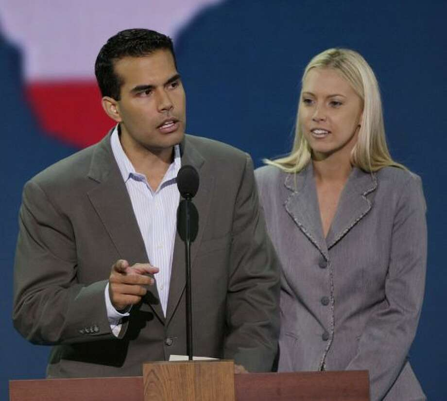 George P. Bush addresses Young Republicans attending the Republican National Convention in 2004 as his wife Amanda looks on.
