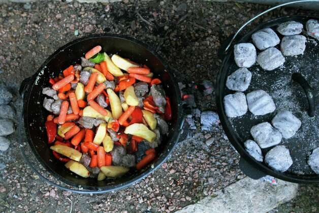 Veggies are added to a moroccan lamb stew during the Fifth Annual Wang Dang Doodle Dutch Oven Cook-Off at the home of Cheryl and John Schilhab near Boerne, Saturday, Nov. 17, 2012. Photo: Jennifer Whitney, For The Express-News / © Jennifer Whitney