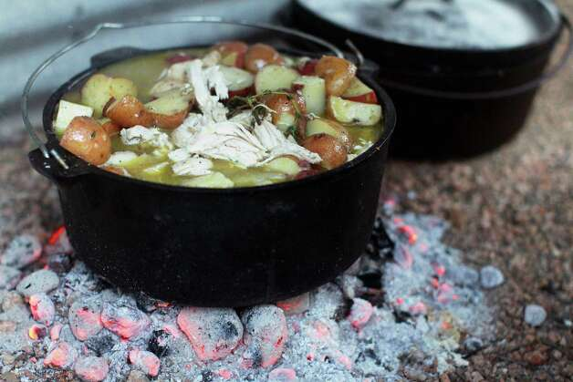 A chicken stew simmers during the Fifth Annual Wang Dang Doodle Dutch Oven Cook-Off at the home of Cheryl and John Schilhab near Boerne, Saturday, Nov. 17, 2012. Photo: Jennifer Whitney, For The Express-News / © Jennifer Whitney