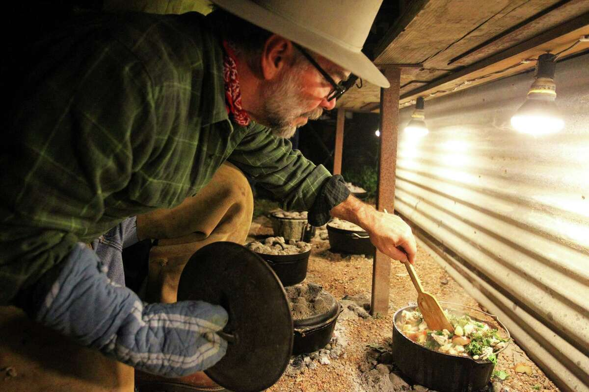 David Pipes stirs a stew during the Wang Dang Doodle Dutch Oven Cook-Off at the home of Cheryl and John Schilhab in Boerne.