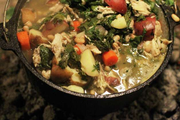 Chicken kale stew with cannellini beans simmers during the Fifth Annual Wang Dang Doodle Dutch Oven Cook-Off at the home of Cheryl and John Schilhab near Boerne, Saturday, Nov. 17, 2012. Photo: Jennifer Whitney, For The Express-News / © Jennifer Whitney