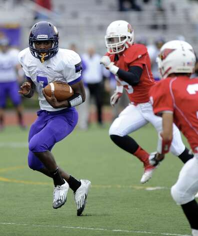 Westhill's Davell Cotterell carries the ball during Saturday's football game against Greenwich High School at Westhill High School on October 27, 2012. Photo: Lindsay Niegelberg / Stamford Advocate
