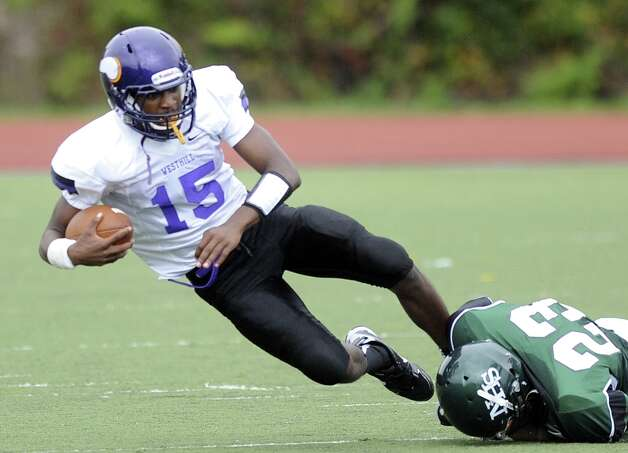 Westhill's Davell Cotterell carries the ball during Saturday's football game against Norwalk High School at Westhill High School on September 29, 2012. Photo: Lindsay Niegelberg / Stamford Advocate