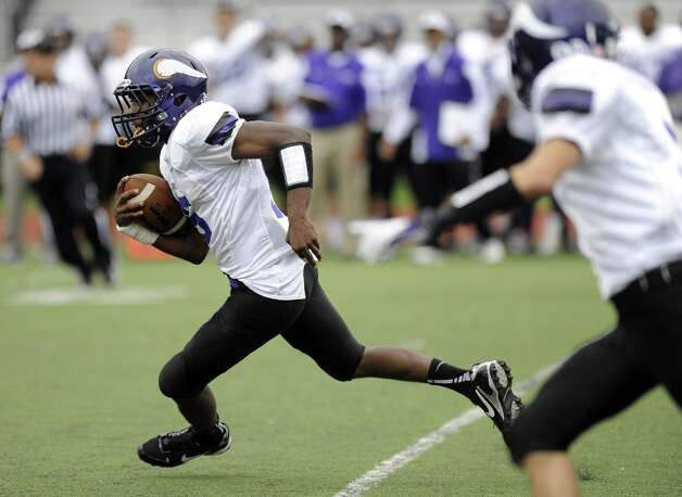 Westhill's Davell Cotterell carries the ball after catching an interception during Saturday's football game against Norwalk High School at Westhill High School on September 29, 2012. Photo: Lindsay Niegelberg / Stamford Advocate