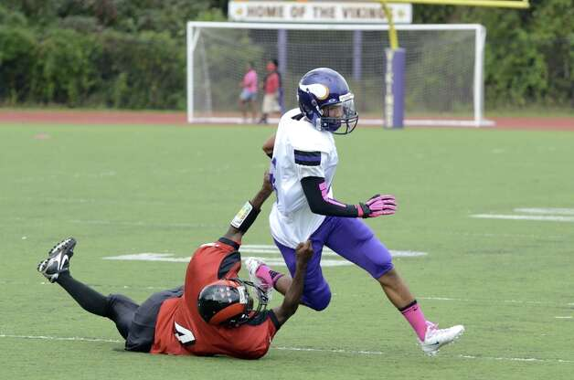 Central's Dequan Crawford (4) defends against Westhill's Randy Barahona (6) during the football game at Westhill High School on Saturday, Oct. 6, 2012. Photo: Amy Mortensen / Connecticut Post Freelance