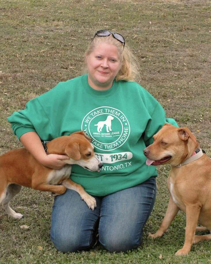 Animal Defense League of Texas volunteer Jamie Doyen works with Baby, left, and Carmella. Photo: Animal Defense League Of Texas