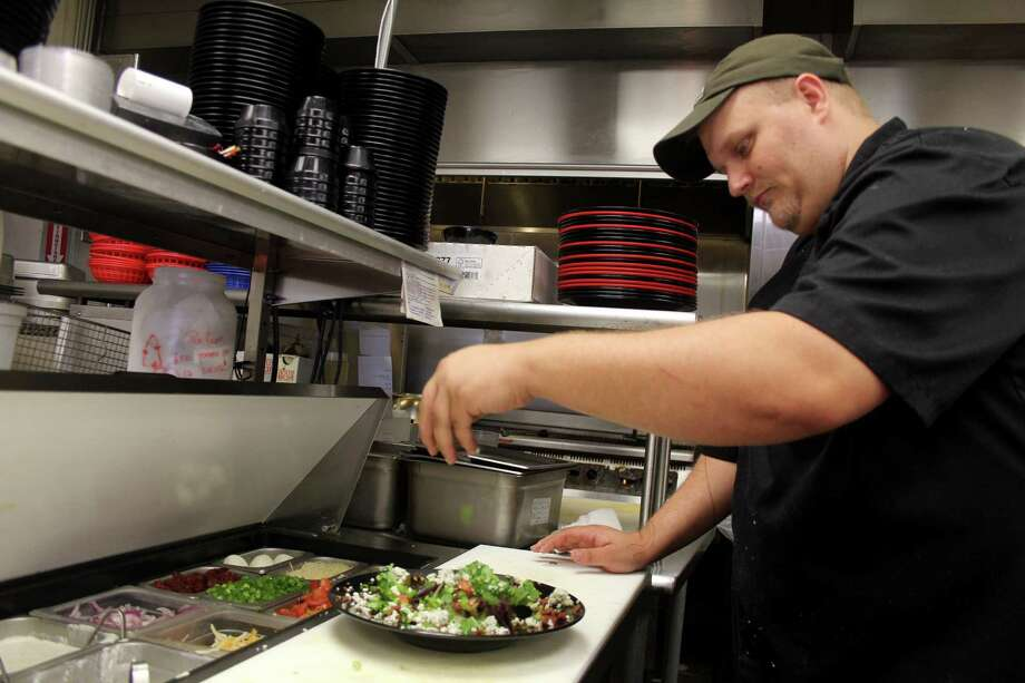"""Cypress resident Cody Hix, a chef at All Stars Family Grill in Richmond, has always had a passion for cooking. He is scheduled to compete on the Food Network show """"Chopped,"""" which will film this spring and air in next fall.   Suzanne Rehak/For the Chronicle Photo: Suzanne Rehak, Freelance Photographer"""