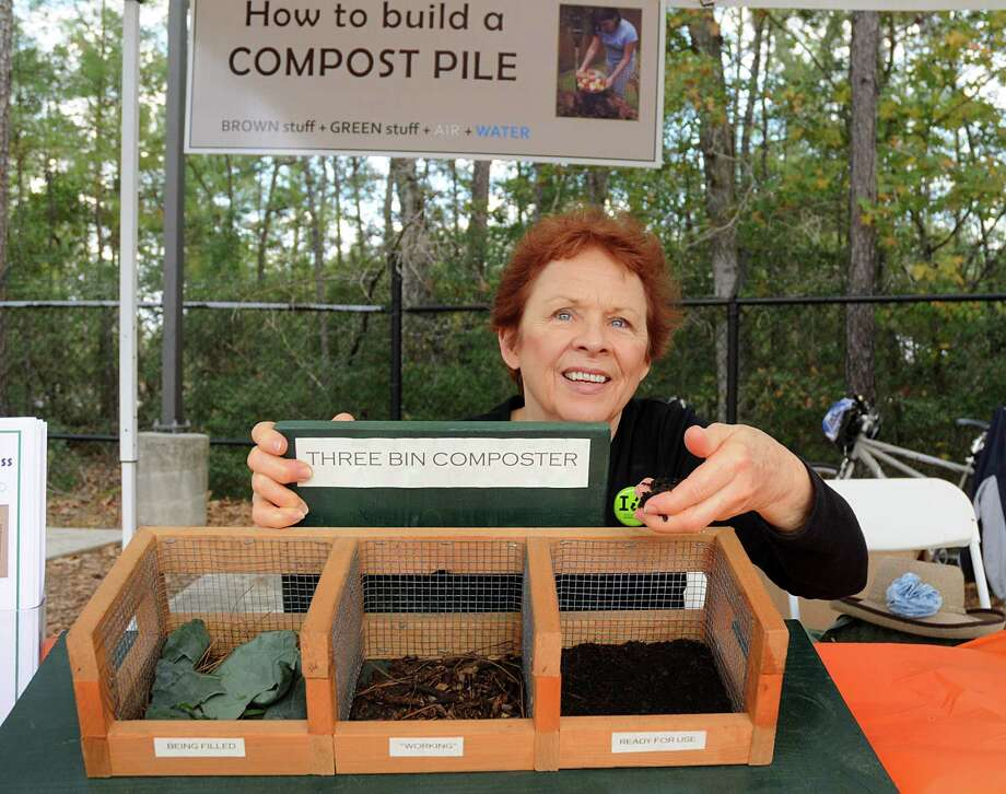 Linda Crum demonstrates using a three-bin composter during the 3R Bazaar and Compost Fair in The Woodlands on Nov. 12. Photo: David Hopper, Freelance / freelance