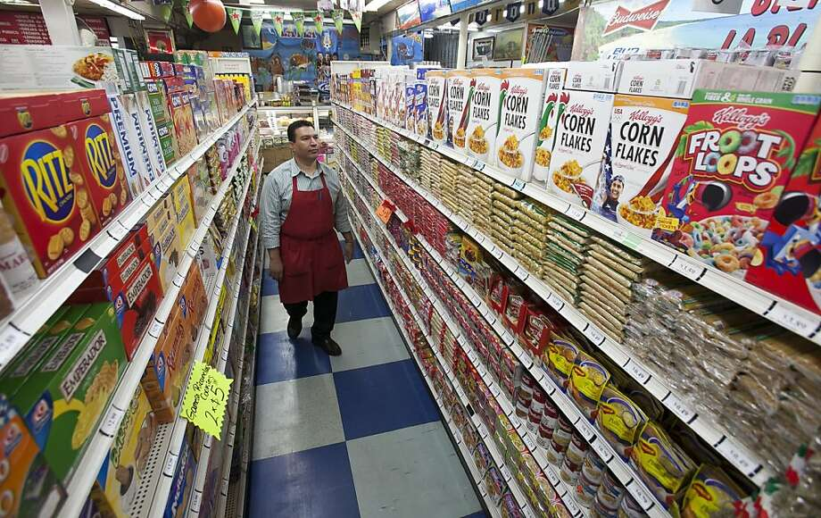 Owner Ray Martinez stands in his La Playa Market in Inglewood (Los Angeles County). He was among those opposed to Proposition 37 in this month's election. Photo: Damian Dovarganes, Associated Press