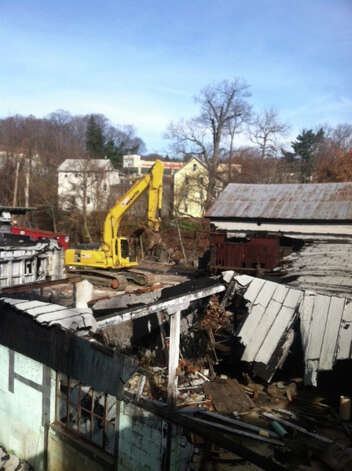 Demolition has resumed at the site of the former Housatonic Wire Co. in Seymour, Conn. on Tuesday, Nov. 20, 2012. The former factory building was destroyed in a massive fire in September 2010, leaving it in rubble and creating an eyesore. Photo: Contributed Photo / Connecticut Post Contributed
