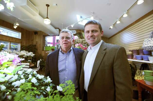 Jim McArdle, left and his son James McArdle III of McArdle's Florist & Garden Center, celebrating 100 years in business in Greenwich, on Tuesday, April 20, 2010. Photo: Helen Neafsey, ST / Greenwich Time