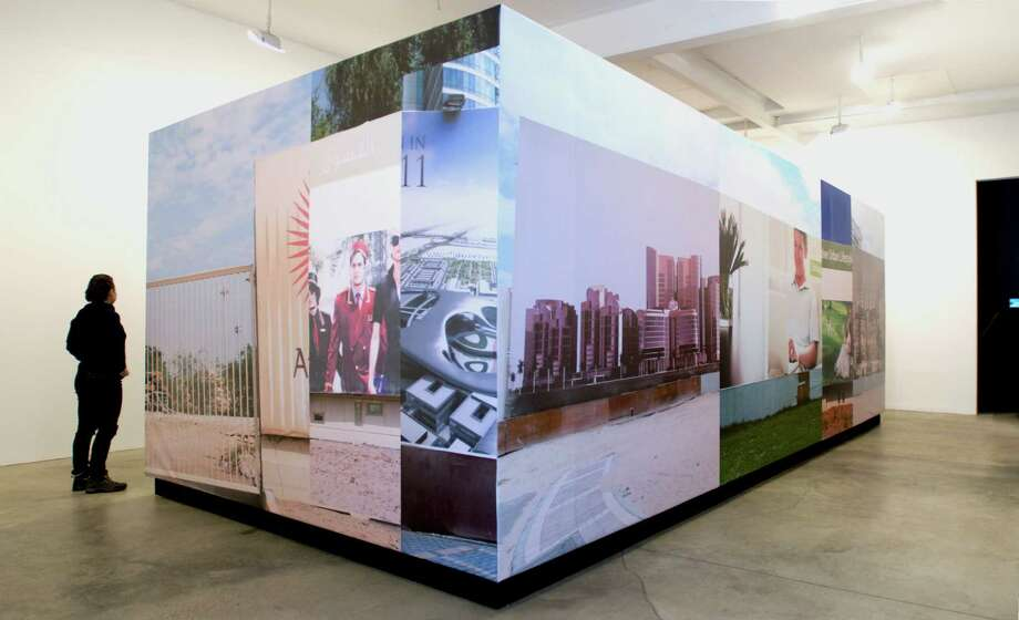 """Installation view of """"Abu Dhabi is Love Forever,"""" by Jennifer and Kevin McCoy at the Teaching Gallery at Hudson Valley Community College. (HVCC)"""