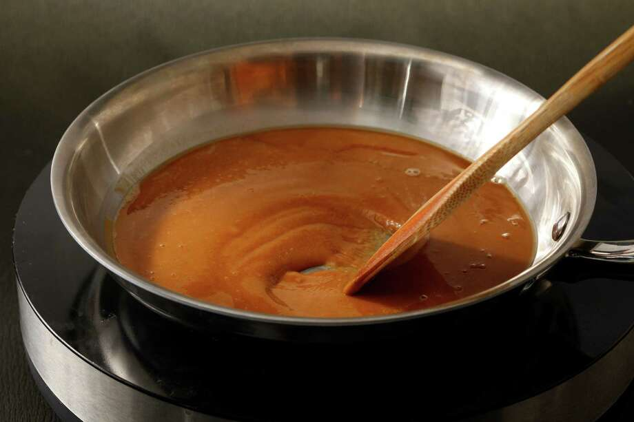 Oil and clarified butter are a good start to making brown roux. Photo: Craig Lee, Special To The Chronicle / ONLINE_YES