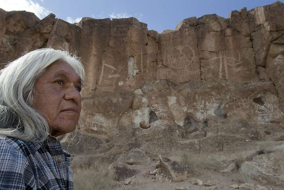 Raymond Andrews, tribal historic preservation officer of the Bishop Paiute Tribe, visits the public land where several ancient petroglyphs were crudely excised from the cliffs and several others were defaced. Photo: Don Kelsen, Associated Press