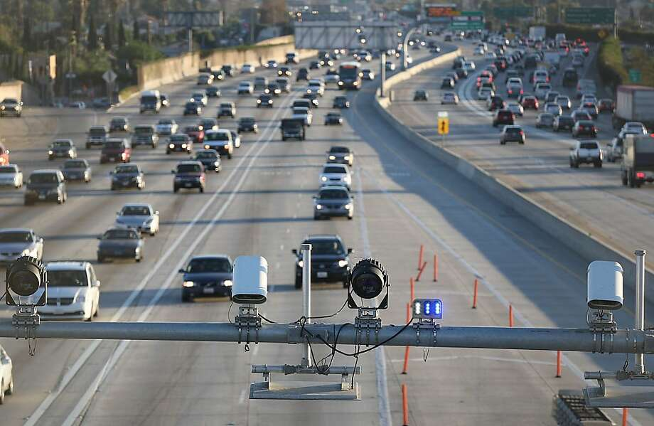 Cameras and sensors watch over the express lane south of the Slauson transit station on the 110 freeway. Photo: Robert Gauthier, Associated Press