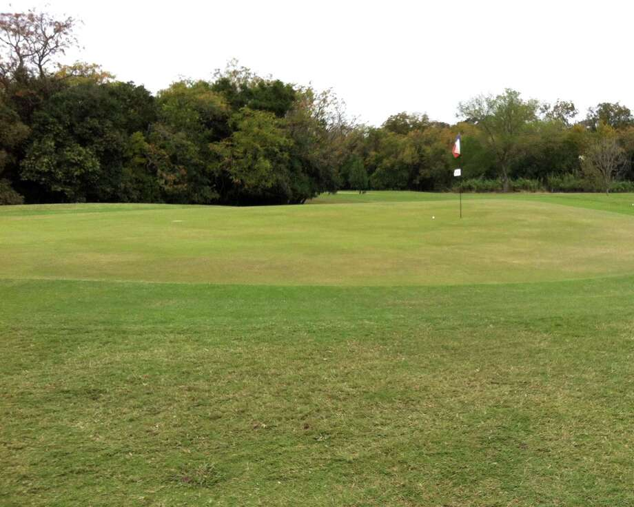 An accurate tee shot takes the undulations of the par-3 No. 7 green at Landa Park Golf Course in New Braunfels out of the picture.