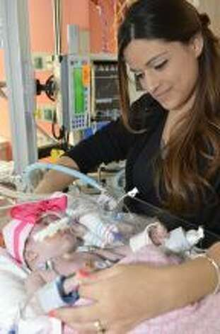 A baby girl who was born with her heart outside of her body is defying the odds and recovering after lifesaving surgery at Texas Children's Hospital, where she was born five weeks ago. Audrina Cardenas? condition was discovered during an ultrasound 16 weeks into her mother's pregnancy. The mother, from Midland, Texas, was referred to Texas Children's, where a team of doctors worked together on her care after she was born. Photo: Texas Children's Hospital