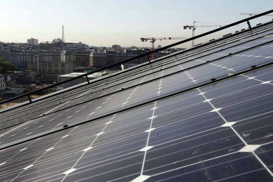 11. Paris:A photo taken on October 22, 2012 shows panels of a photovoltaic power station installed on the roof of a building in the new Clichy-Batignolles district in Paris. AFP PHOTO / KENZO TRIBOUILLARD Photo: KENZO TRIBOUILLARD, AFP/Getty Images / 2012 AFP
