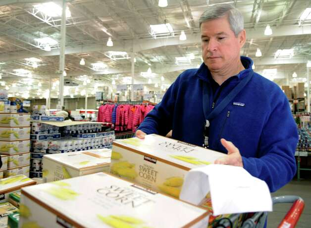 Priceline CEO Jeff Boyd loads sweet corn into a shopping cart at Costco in Norwalk on Tuesday, November 20, 2012. Priceline donated 19,404 pounds of food to the Food Bank of Lower Fairfield County. Photo: Lindsay Niegelberg / Stamford Advocate