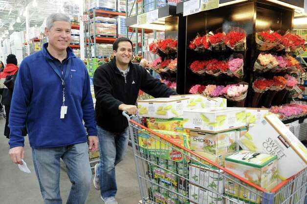 Priceline CEO Jeff Boyd walks with a part of Priceline's donation from Costco in Norwalk to the Food Bank of Lower Fairfield County on Tuesday, November 20, 2012. Photo: Lindsay Niegelberg / Stamford Advocate