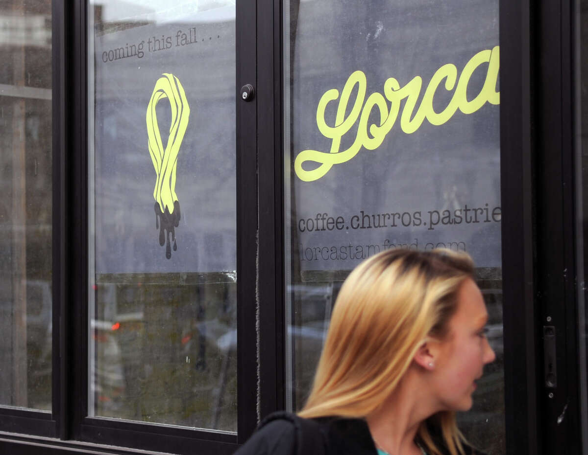 A woman walks past the storefront that will be Lorca, a new bakery and coffeeshop on Bedford Street in Stamford, on Tuesday, November 20, 2012. Lorca is scheduled to open this year.