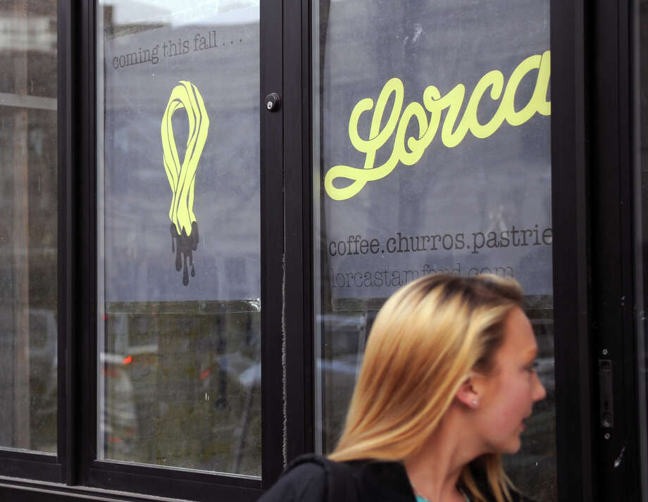 A woman walks past the storefront that will be Lorca, a new bakery and coffeeshop on Bedford Street in Stamford, on Tuesday, November 20, 2012. Lorca is scheduled to open this year. Photo: Lindsay Niegelberg / Stamford Advocate