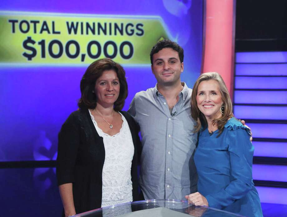 "Danbury native Rob Vitolo, who won $100,000 on ABC's ""Who Wants To Be A Millionaire,"" is shown here with his mother, Louise Vitolo, at left, and television host Meredith Vieira. Photo: Contributed Photo"