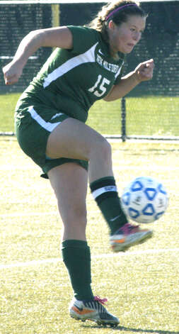 The Green Wave's Maddy Ranno fights off a tough ball during New Milford High School girls' soccer's state class 'LL' semifinal match vs. Newtown in Waterbury. Nov. 17, 2012 Photo: Norm Cummings