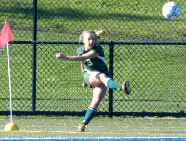 Jen Millar of the Green Wave surefoots a corner kick during New Milford High School girls' soccer's state class 'LL' semifinal match vs. Newtown in Waterbury. Nov. 17, 2012 Photo: Norm Cummings