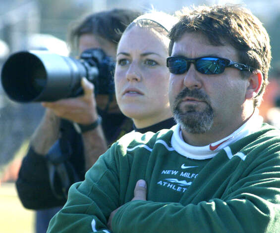 Green Wave coaches Greg LaCava and Karra Damascus shrug off the nearby presence of media types to focus on New Milford High School girls' soccer's state class 'LL' semifinal match vs. Newtown in Waterbury. Nov. 17, 2012 Photo: Norm Cummings