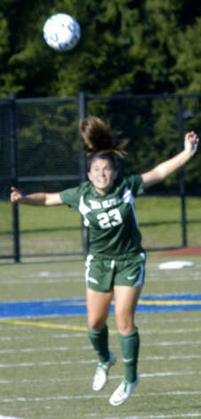 Bre Rehaag of the Green Wave uses her head to get positive results during New Milford High School girls' soccer's state class 'LL' semifinal match vs. Newtown in Waterbury. Nov. 17, 2012 Photo: Norm Cummings