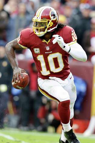 Washington Redskins quarterback Robert Griffin III runs with ball during the second half of an NFL football game against the Philadelphia Eagles in Landover, Md., Sunday, Nov. 18, 2012. (AP Photo/Alex Brandon) Photo: Alex Brandon, Associated Press / AP