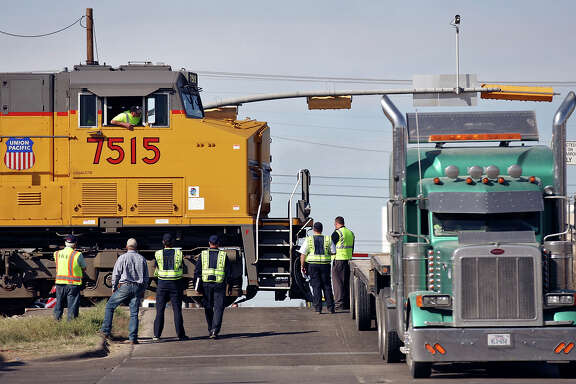 Officials take part in a National Transportation Safety Board sight distance test, Tuesday Nov. 20, 2012 in Midland, Tx., at the intersection of the Union Pacific railroad tracks on South Garfield Street, near West Industrial Avenue where a Union Pacific train struck a parade float at 4:36 p.m. Thursday Nov. 15, 2012, killing four veterans injured in combat.