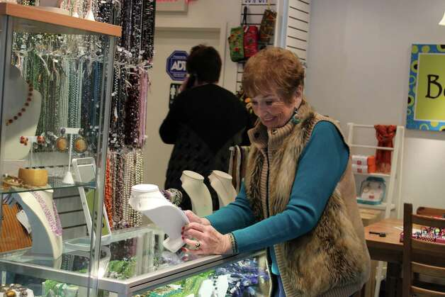 Conny Pernod browses some of the jewelry at Beadz Boutique for the holidays. Photo: Megan Davis