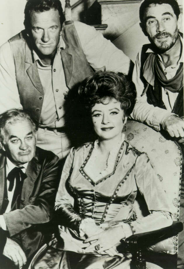 "James Arness, Amanda Blake, Milburn Stone, and Ken Curtis star in television's longest running western, ""Gunsmoke."" The show premiered on CBS on September 10, 1955. (PHOTO UNDATED) CREDIT: EXPRESS-NEWS FILE PHOTO Photo: FILE PHOTO / EXPRESS-NEWS FILE PHOTO"