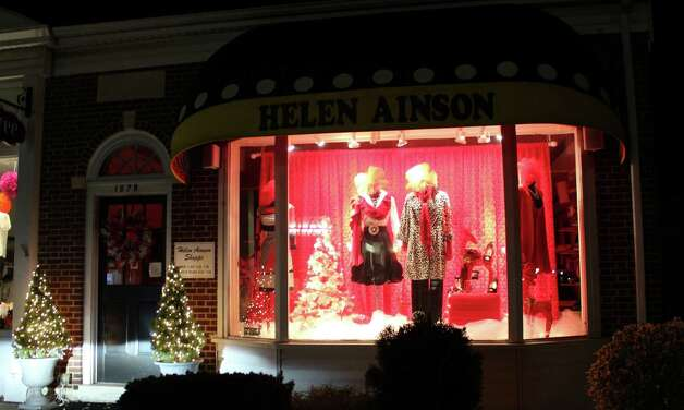 A holiday display is lit up in Helen Ainson's window for the holiday season. Photo: Megan Davis