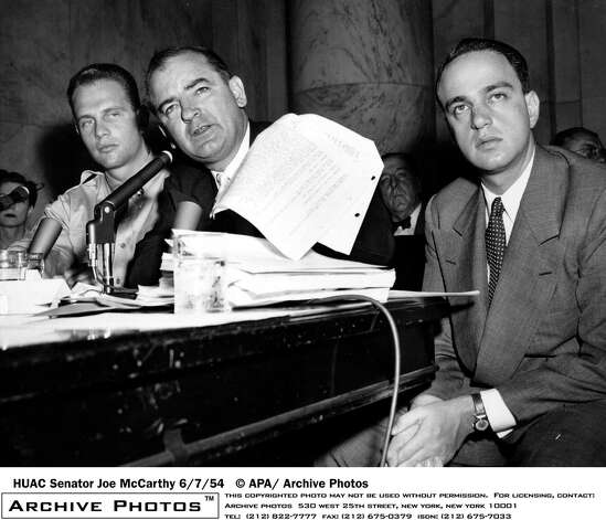 Roy Cohn (right) was Senator Joe McCarthy's (center) chief counsel. Cohn died in 1986 of complications from AIDS. Photo: Hulton Archive, Getty Images / 2003 Getty Images