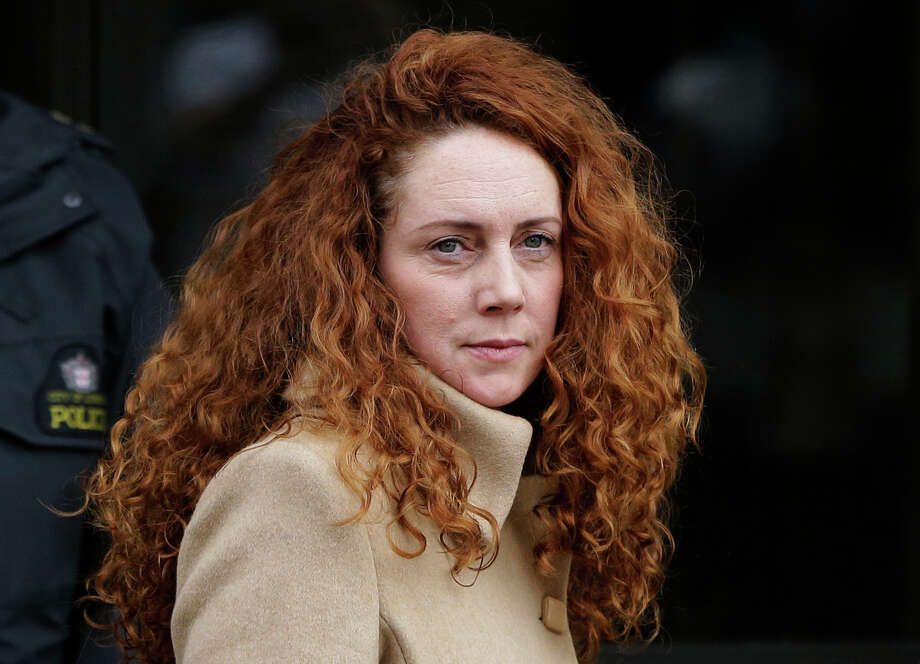 FILE This Wednesday, Sept. 26, 2012 file photo shows Rebekah Brooks, the former chief of News Corp.'s British operations, leaving the Old Bailey court in London London.  Officials have charged the British prime minister's former media aide and the ex-chief of Rupert Murdoch's News International with bribery offenses. Britain's Crown Prosecution Service said Tuesday Nov. 20, 2012 that Andy Coulson and Rebekah Brooks were among four people being charged with conspiracy to commit misconduct in public office.    (AP Photo/Lefteris Pitarakis, File) Photo: Lefteris Pitarakis, STF / AP