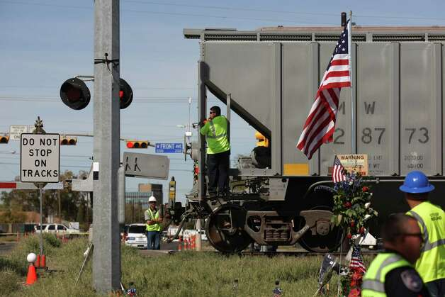 Officials prepare for a National Transportation Safety Board sight distance test, Tuesday Nov. 20, 2012 in Midland, Tx., at the intersection of the Union Pacific railroad tracks on South Garfield Street, near West Industrial Avenue where a Union Pacific train struck a parade float at 4:36 p.m. Thursday Nov. 15, 2012, killing four veterans injured in combat. Photo: Edward A. Ornelas, San Antonio Express-News / © 2012 San Antonio Express-News